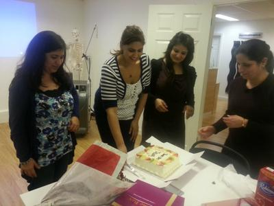 students cutting cake to say thank you